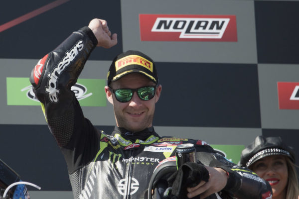 PORTIMAO, PORTUGAL - SEPTEMBER 16: Jonathan Rea of Great Britain and KAWASAKI RACING TEAM WorldSBK celebrates the victory on the podium during the Supersbike race 2 during the Motul FIM Superbike World Championship - Race 2 at Algarve Motor Park on September 16, 2018 in Portimao, Portugal. (Photo by Mirco Lazzari gp/Getty Images)